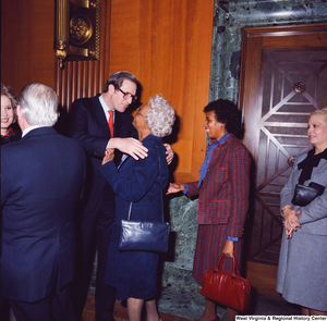 "[""Senator John D. (Jay) Rockefeller hugs an unidentified supporter at the Senate Swearing-In Ceremony.""]%"