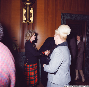 "[""Sharon Rockefeller shakes hands with supporters at her husband's Senate Swearing-In Ceremony.""]%"