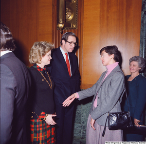 "[""Sharon Rockefeller and her husband Senator John D. (Jay) Rockefeller greet an unidentified supporter at the Senate Swearing-In Ceremony.""]%"