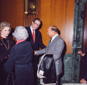 "[""Senator John D. (Jay) Rockefeller and his wife Sharon shake hands with unidentified supporters following the Senate Swearing-In Ceremony.""]%"