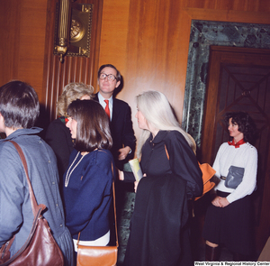 "[""Senator John D. (Jay) Rockefeller and his wife Sharon are greeted by a crowd of unidentified supporters following the Senate Swearing-In Ceremony.""]%"