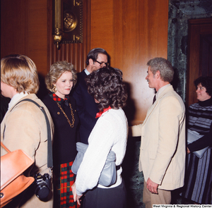 "[""Senator John D. (Jay) Rockefeller and his wife Sharon greet four unidentified supporters after the Senate Swearing-In Ceremony.""]%"