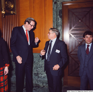 "[""Senator John D. (Jay) Rockefeller speaks with an unidentified supporter after the Senate Swearing-In Ceremony.""]%"