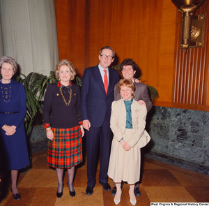 "[""Senator John D. (Jay) Rockefeller, his wife Sharon, and two unidentified supporters smile for a photograph after the Senate Swearing-In Ceremony. Senator Robert C. Byrd's wife, Erma, can be seen standing on the left.""]%"