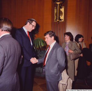 "[""Senator John D. (Jay) Rockefeller greets and shakes hands with an unidentified supporter at the Senate Swearing-In Ceremony.""]%"