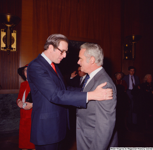 "[""Senator John D. (Jay) Rockefeller embraces an unidentified supporter at the Senate Swearing-In Ceremony""]%"