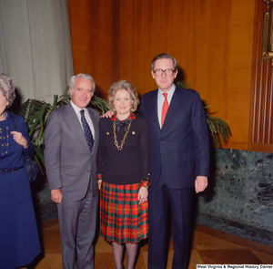 "[""An unidentified supporter poses for a photograph with Senator John D. (Jay) Rockefeller and his wife Sharon at the Senate Swearing-In Ceremony.""]%"