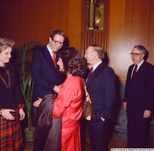 "[""Senator John D. (Jay) Rockefeller and his wife Sharon greet unidentified supporters at the Senate Swearing-In Ceremony.""]%"