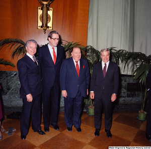 "[""Senator John D. (Jay) Rockefeller, Senator Robert C. Byrd, and former Senator Jennings Randolph pose for a photograph with an unidentified individual at the Senate Swearing-In Ceremony.""]%"