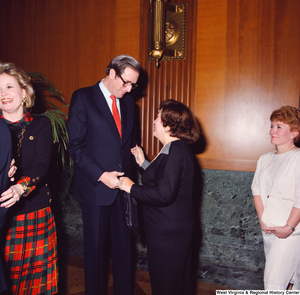 "[""Senator John D. (Jay) Rockefeller shakes hands with an unidentified supporter at the Senate Swearing-In Ceremony.""]%"