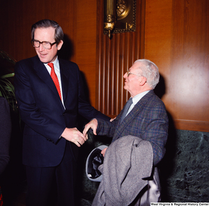 "[""Senator John D. (Jay) Rockefeller greets an unidentified supporter at the Senate Swearing-In Ceremony.""]%"