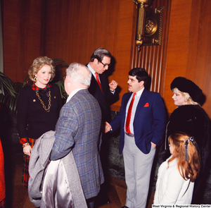 "[""Senator John D. (Jay) Rockefeller shakes hands with an unidentified supporter while his wife Sharon talks with another following the Senate Swearing-In Ceremony.""]%"