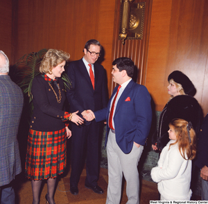"[""Senator John D. (Jay) Rockefeller and his wife Sharon greet unidentified supporters after the Senate Swearing-In Ceremony.""]%"