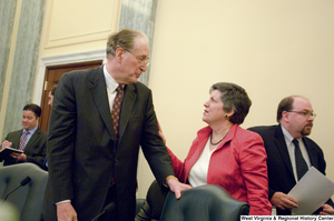 "[""Senator John D. (Jay) Rockefeller speaks with Secretary of Homeland Security Janet Napolitano before a Commerce Committee hearing.""]%"