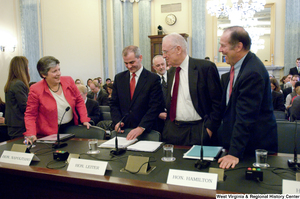 "[""Secretary of Homeland Security Janet Napolitano speaks with three other men before a Senate Commerce Committee hearing.""]%"