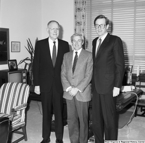 "[""Senator John D. (Jay) Rockefeller stands in front of the desk in his office with two representatives from the American Society of Travel Agents.""]%"