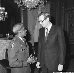"[""Senator John D. (Jay) Rockefeller speaks with Major General Ernest Harrell in a Senate building.""]%"
