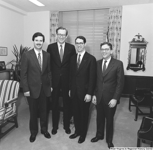 "[""Senator John D. (Jay) Rockefeller stands for a photograph in his office with three representatives from the Independent Oil and Gas Association.""]%"