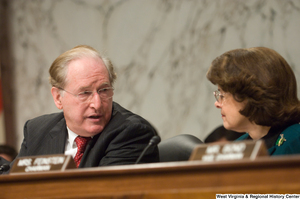 "[""Senator John D. (Jay) Rockefeller and Senator Dianne Feinstein speak during a Select Committee on Intelligence hearing.""]%"