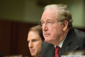 "[""Senator John D. (Jay) Rockefeller listens to testimony at an intelligence hearing.""]%"