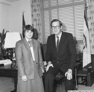"[""Senator John D. (Jay) Rockefeller sits on his desk and poses for a photograph with an unidentified individual.""]%"
