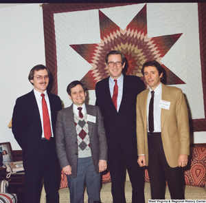 "[""This color photograph shows Senator John D. (Jay) Rockefeller posing for a photograph with representatives from the West Virginia Family Resource Network.""]%"