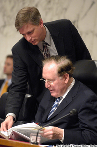 "[""Senator John D. (Jay) Rockefeller reviews a document during a Senate committee hearing on intelligence.""]%"
