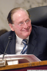 "[""Senator John D. (Jay) Rockefeller smiles during a Senate intelligence committee hearing.""]%"