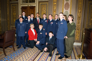 "[""President Barack Obama poses for a photograph with members of the Air Force during a visit to the U.S. Capitol Building.""]%"