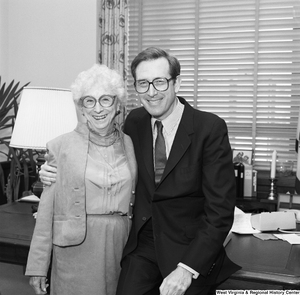 "[""Senator John D. (Jay) Rockefeller and a woman from the Education School Budget Group hug and pose for a photograph in his office.""]%"