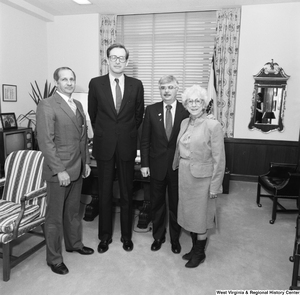"[""Senator John D. (Jay) Rockefeller and three representatives from the Education School Budget Group stand for a photograph beside a chair in his office.""]%"