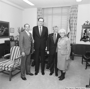 "[""Senator John D. (Jay) Rockefeller stands in his office with three representatives from the Education School Budget Group.""]%"