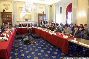"[""Senators and Congressmen gather at a joint session of the Commerce Committee.""]%"