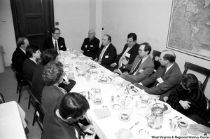 "[""Senator John D. (Jay) Rockefeller sits with representatives from West Virginia hospitals at a breakfast event in the Senate.""]%"