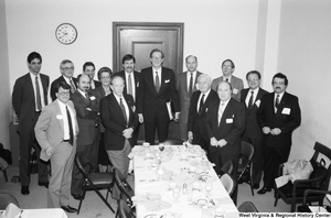 "[""Senator John D. (Jay) Rockefeller stands for a photograph with representatives from West Virginia hospitals after a breakfast reception in the Senate.""]%"