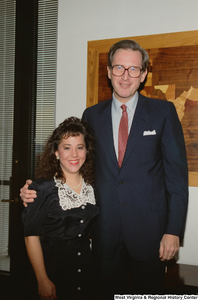 "[""Senator John D. (Jay) Rockefeller with a young woman visiting his office.""]%"