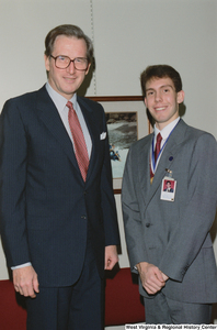 "[""Senator John D. (Jay) Rockefeller stands with a West Virginia participant in the United States Senate Youth Program.""]%"