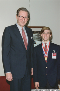 "[""Senator John D. (Jay) Rockefeller stands beside one of the West Virginia participants in the United States Senate Youth Program.""]%"