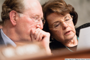 "[""Senators John D. (Jay) Rockefeller and Dianne Feinstein read a document during an Intelligence Committee hearing.""]%"