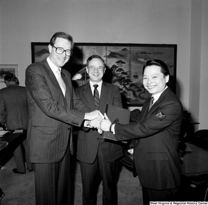 "[""Senator John D. (Jay) Rockefeller shakes hands with a representative of the China Steel company.""]%"