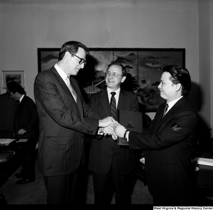 "[""Senator John D. (Jay) Rockefeller shakes hands with representative of China Steel in his office.""]%"