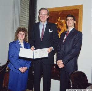 "[""Senator John D. (Jay) Rockefeller stands with two United States Senate Youth Program delegates from West Virginia.""]%"