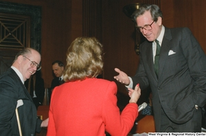 "[""Senator John D. (Jay) Rockefeller speaks with a woman after a Senate sub-committee hearing.""]%"