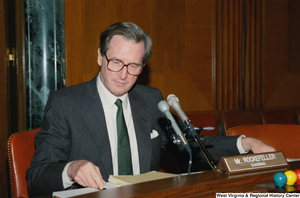 "[""Senator John D. (Jay) Rockefeller sits and looks at his notes during a Senate sub-committee hearing that he is chairing.""]%"