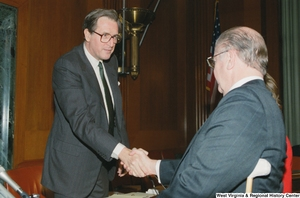 "[""Senator John D. (Jay) Rockefeller shakes hands with a man after a Senate sub-committee.""]%"