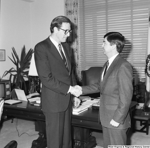 "[""Senator John D. (Jay) Rockefeller shakes hands with an unidentified man in his office.""]%"