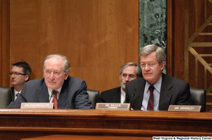 "[""Senators John D. (Jay) Rockefeller and Max Baucus listen to testimony during a Intelligence Committee hearing.""]%"