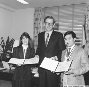 "[""Senator John D. (Jay) Rockefeller stands with the two West Virginia delegates to the 1987 United States Senate Youth Program. This prestigious program and the scholarship associated with it are run by the Hearst Foundations and give two high school students per state, per year the opportunity to attend a week-long Washington program that fosters experience-based knowledge of the Senate and federal government and promotes public service and leadership.""]%"