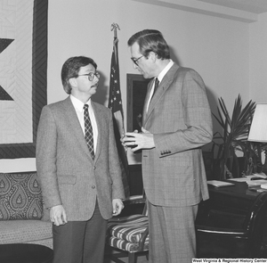 "[""Senator John D. (Jay) Rockefeller speaks with an unidentified man in his office.""]%"