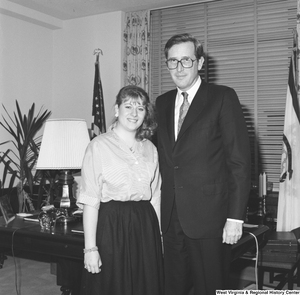 "[""Senator John D. (Jay) Rockefeller stands for a photograph in his office with one of his interns.""]%"